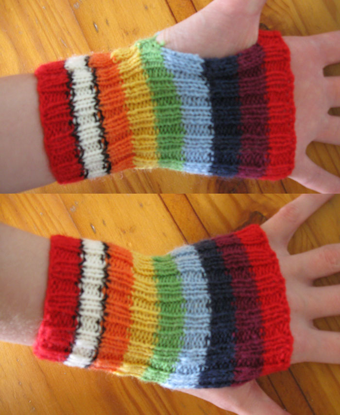 A pair of short ribbed rainbow handwarmers, with 2cm stripes in the following colours, from cuff to knuckles: red, white with black border, orange, yellow, green, blue, indigo, violet, red.