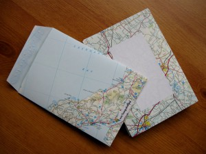 A set of envelopes made from old OS maps.